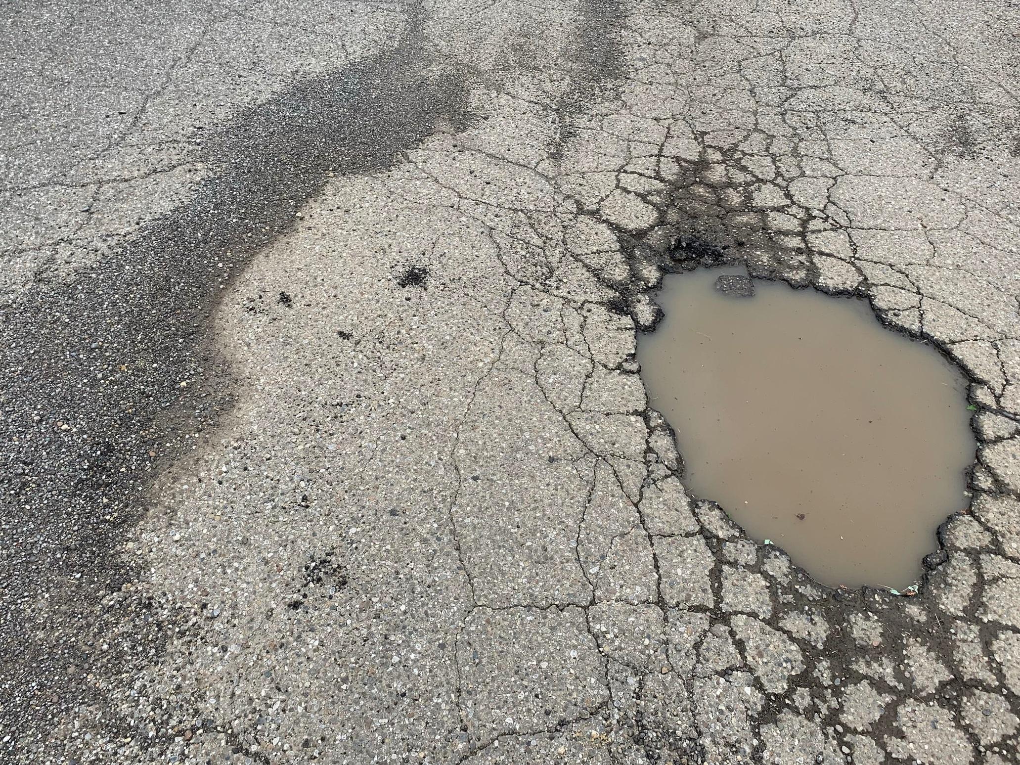 Photo of actual pothole is Seth's neighborhood!