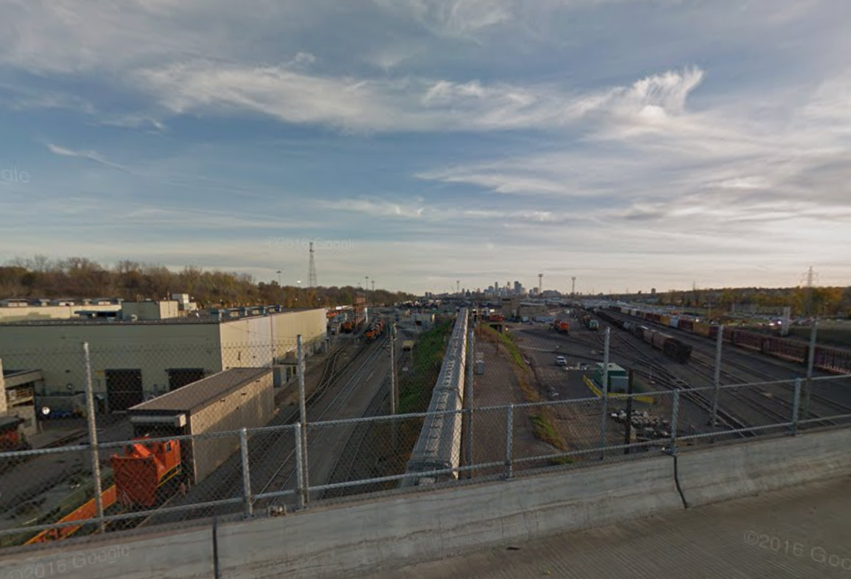 View looking south at the train yards with downtown in the background.  Image courtesy of Google Street View