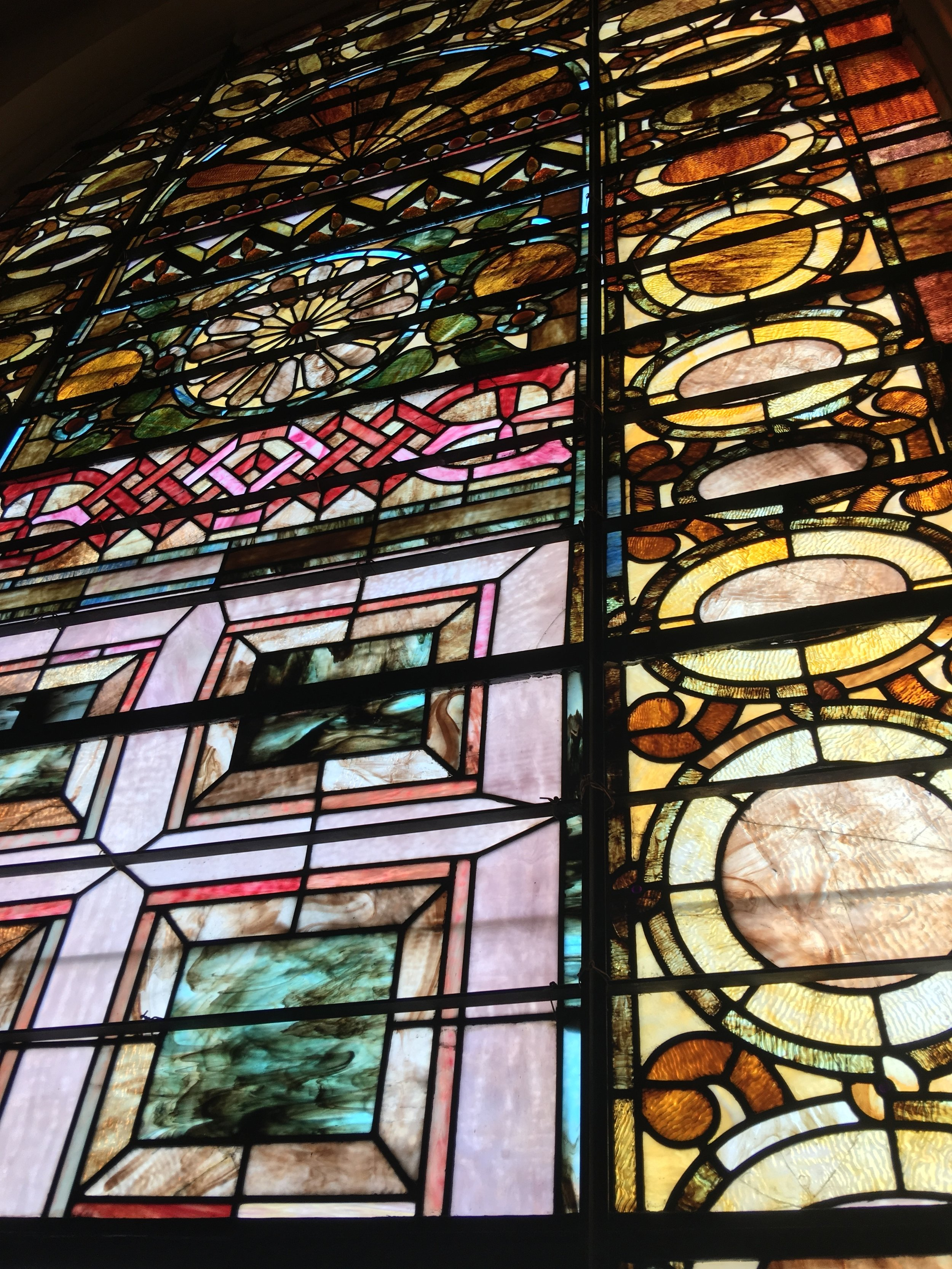 Just one of the many original stained glass windows