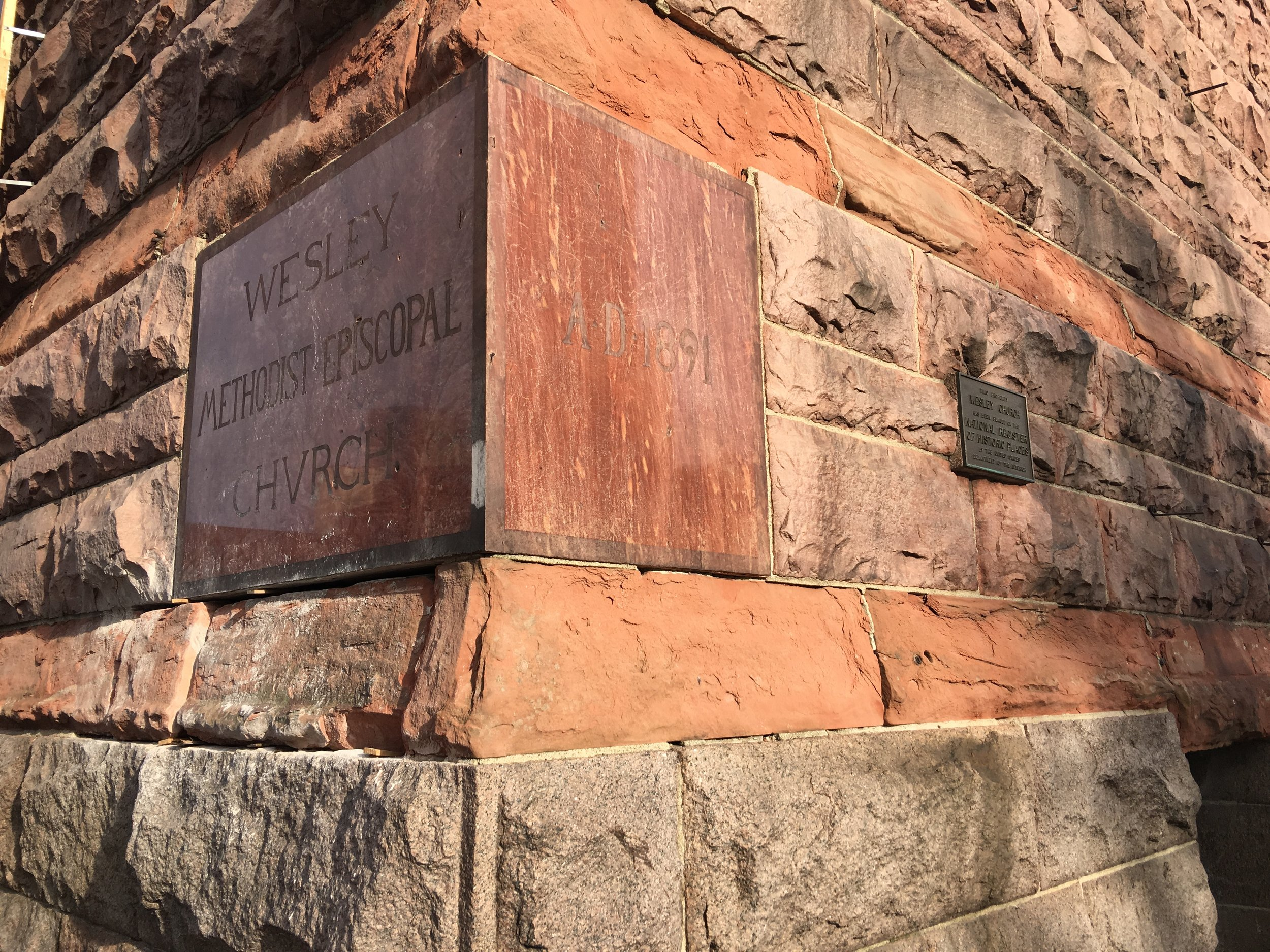 The sandstone block under the left portion of the cornerstone was cut in order to extract the memorobilia box