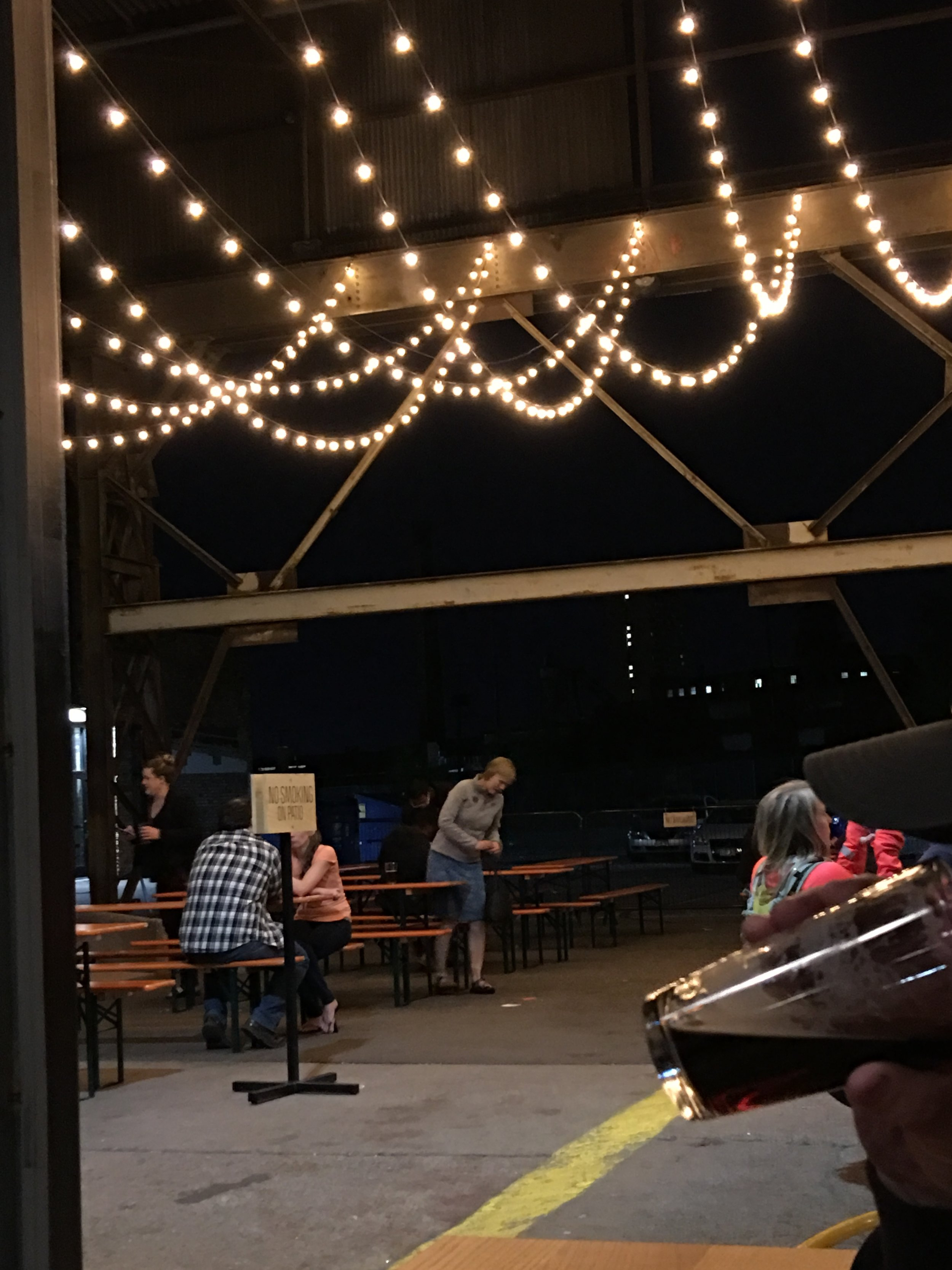 Outdoor patio space at Bauhaus Brew Labs welcoming adults, kids, and dogs in the summer time