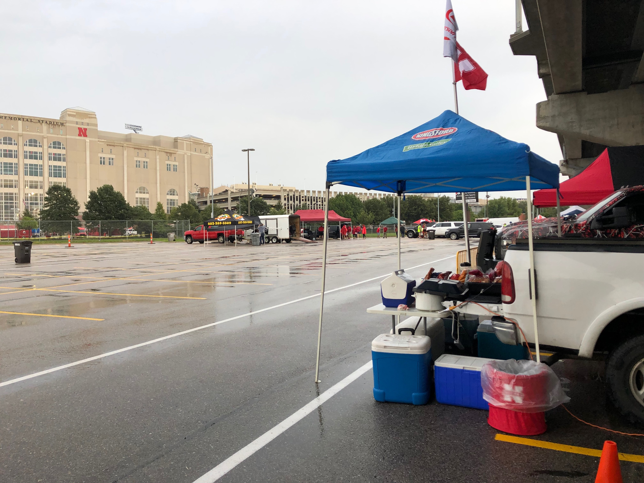 The committee few braving the rain to tailgate