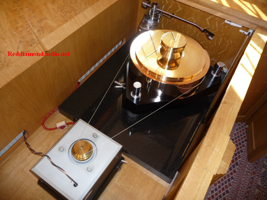 A Melco turntable system.    The Melco 3560 gun metal platter, the 3256 base and 3533 motor unit. Allow 100 kg for the entire setup, excluding the extra 10 kg needed for the large record weight.