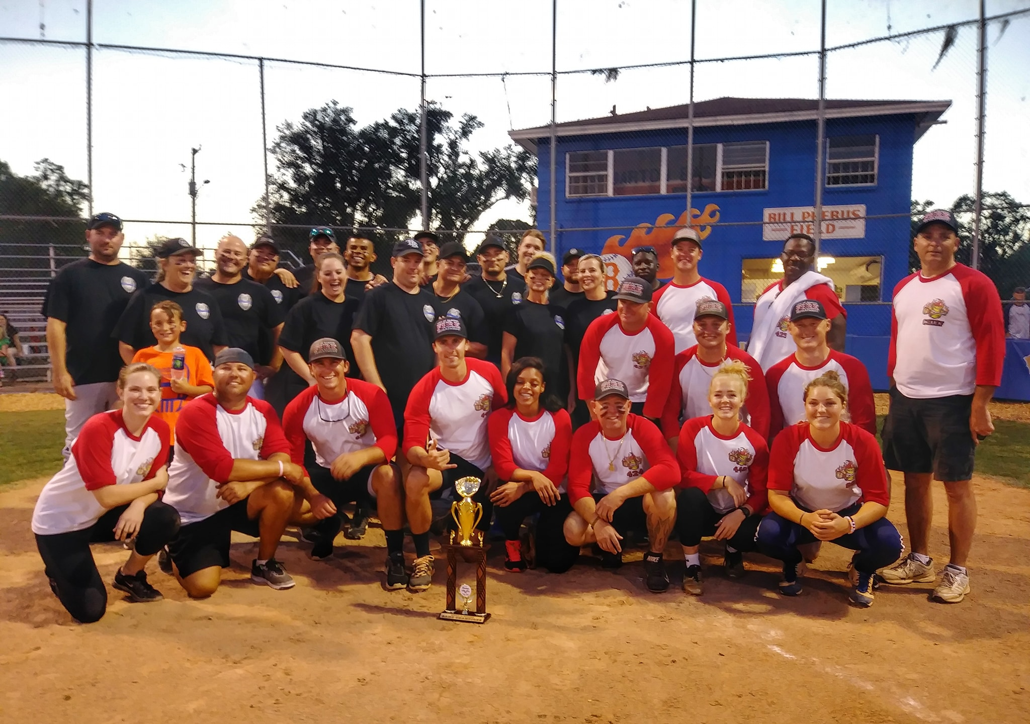 BARTOW - After the game, the winning Bartow Fire Deparment team, side by side, with the competing Bartow Police Department. Special thanks to Bartow High School for hosting this event. Monies and concessions are donated to the George W. Harris Youth Shelter, a shelter that provides temporary safe-haven to youths, ages 10-17, in need.