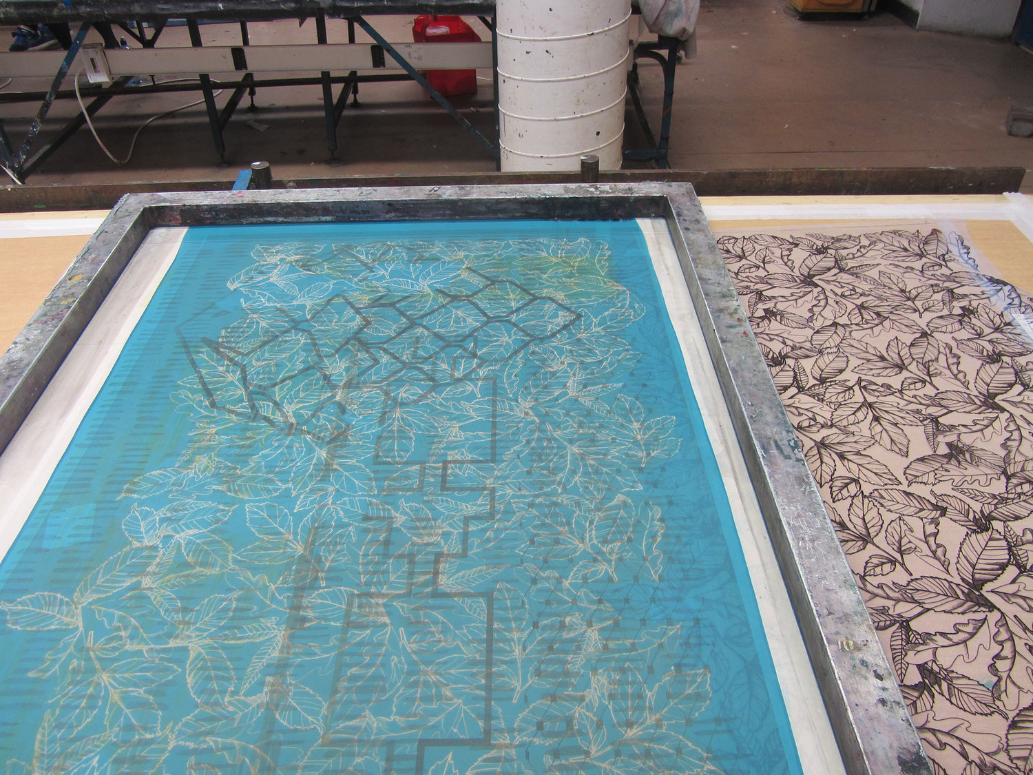 In the screen print studio the leaf drawings are printed onto fabric