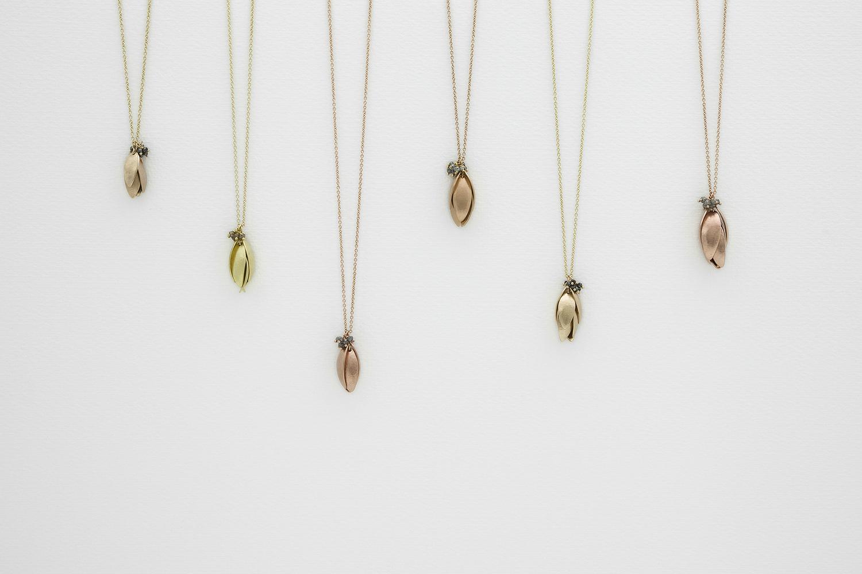 Nestling Pendants in Golds
