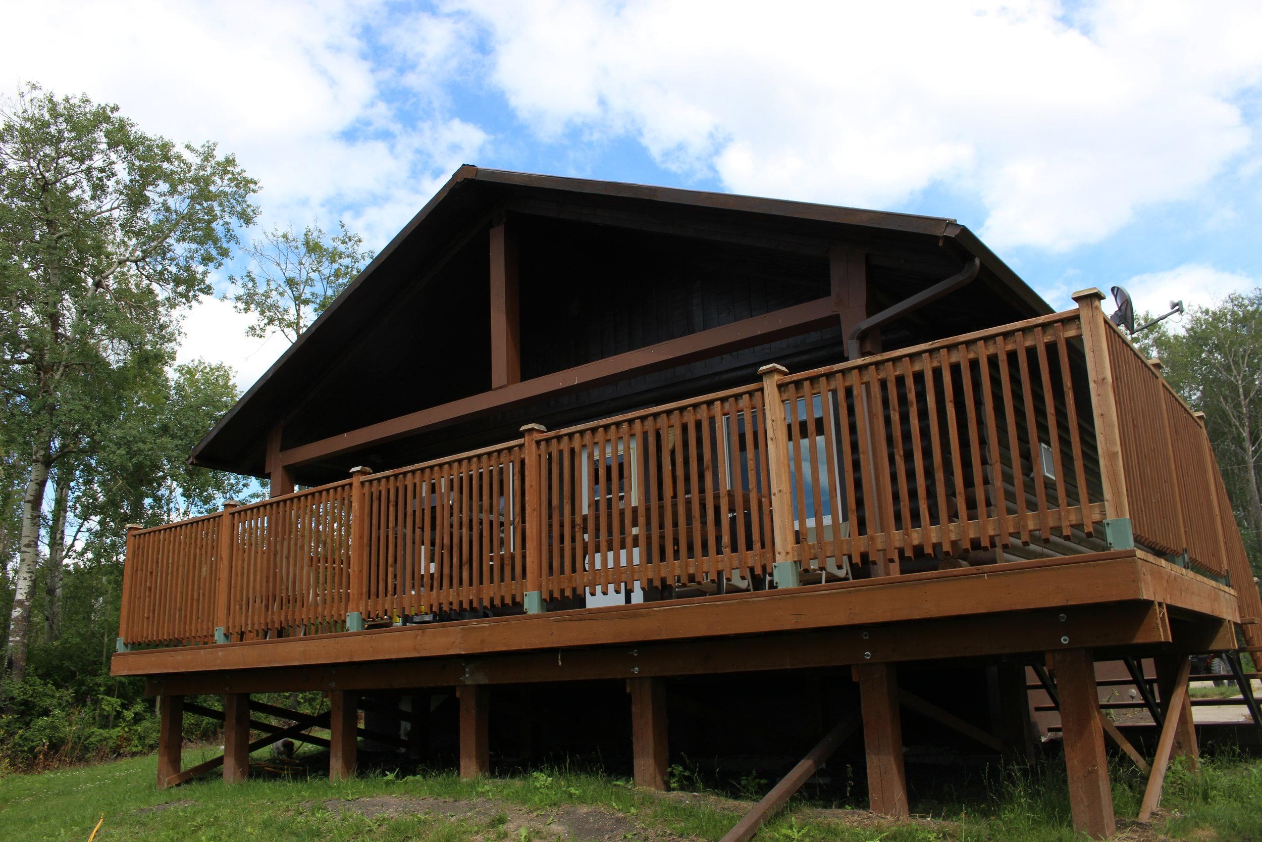 Lake view side of Arrow Lake Ranch's cabin