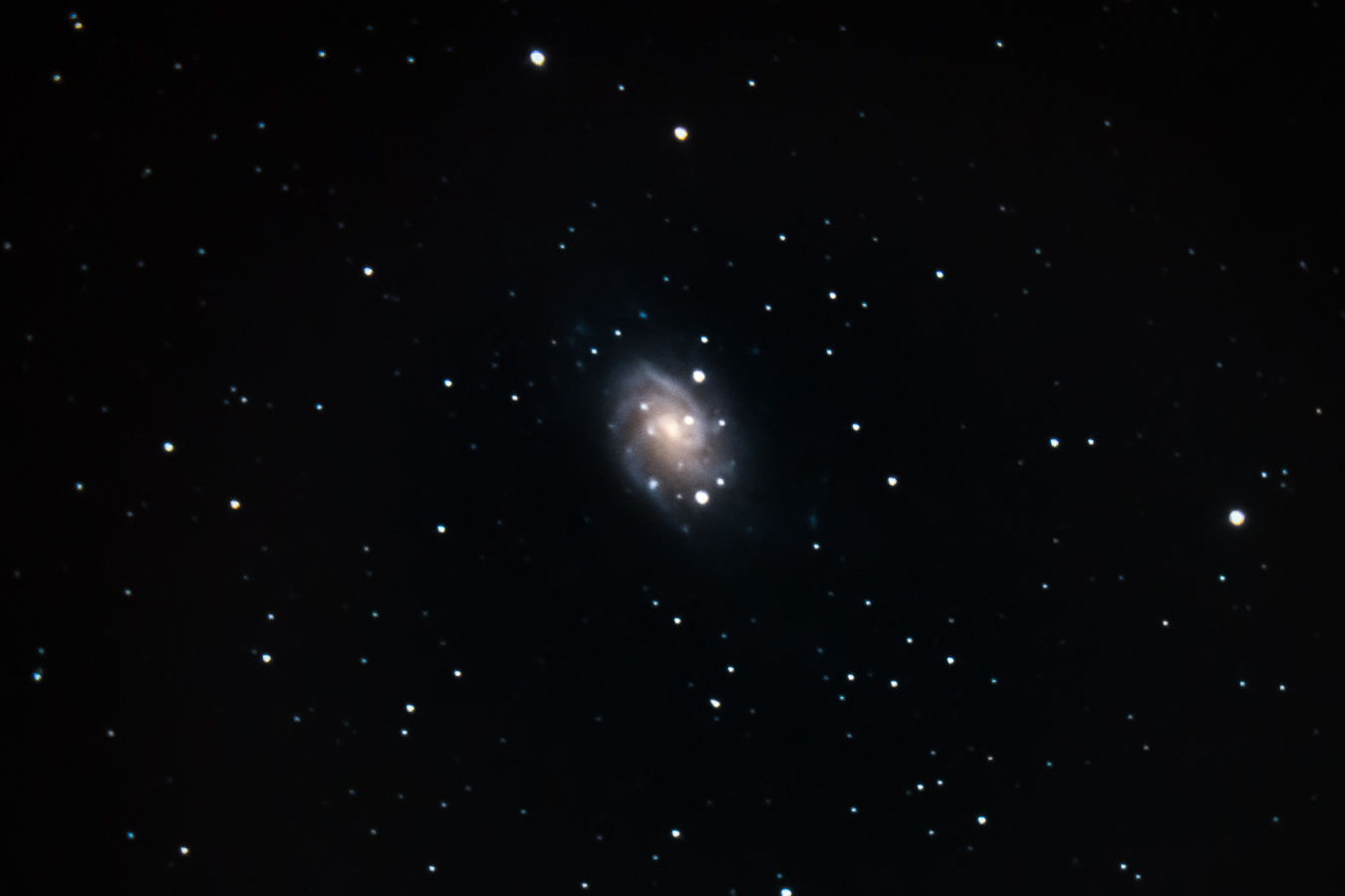 NGC 2403   , a spiral    galaxy    8 million light years away in the obscure constellation    Camelopardalis   . When you view this image, you're looking 8 million years back in time. Captured with my    Celestron    8SE    telescope    somewhere in nowhere between the towns of Santa Barbara and Santa Ynez the night of December 8 2018.