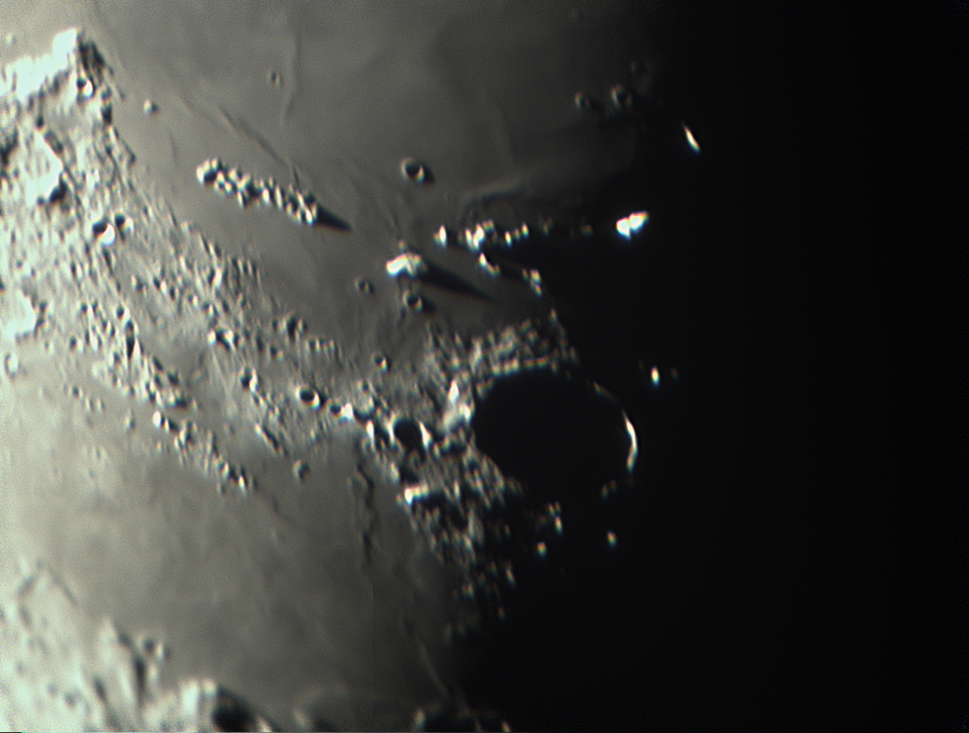 Lunar crater Plato falls into shadow as nightfall hits the waning moon. The quality is not the best—it was hard to get a good image along the terminator without high dynamic range. ZWO 224ASI camera.