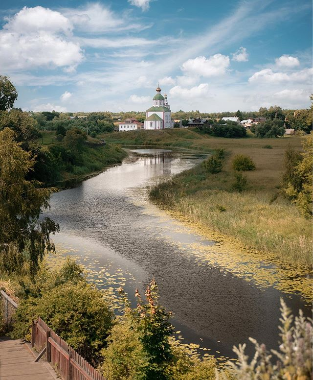 When we first came to Russia, we knew we'd be visiting a lot of different cities but we wanted to experience some of the countryside too and we're so, so glad we made it to Suzdal.  This town is one of the many picturesque stops along a scenic route in Russia called The Golden Ring. The area is known for landscapes like these as well as hundreds of churches, monasteries and kremlins.  Our highlights of the day included: • Buying pickles (like, really good pickles) from a babushka's stand at the side of the road. • Watching kids catch fish off a dock with nothing but a string and a plastic bag. • Experiencing our first traditional Samovar tea ceremony at a cafe we nearly missed and we're definitely writing about this ritual on the blog.  It's funny that the things we loved the most about our visit to Suzdal are ones we couldn't have ever planned for. It has been one surprise after another here in Russia and, if you can, please consider visiting more than just Moscow and St. Petersburg. You won't be disappointed (and you'll probably find some good pickles, too!). . . . #featherandthewind #fromrussiawithlove #russia #suzdal #thegoldenring #russiabeyond #thegoldenringofrussia #beautifuldestinations #bbctravel #TLpicks #russia_travelling_ #russianexplorers #europestyle_russia #lumixgh5 #sharetravelpicks #worlderlust #theculturetrip