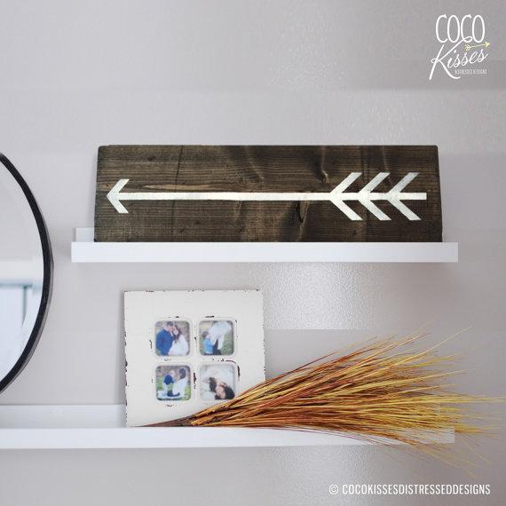 dark wood arrow sign