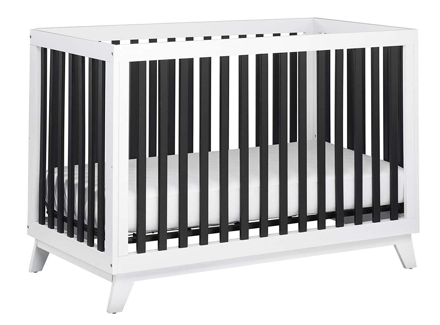 white crib with black bars