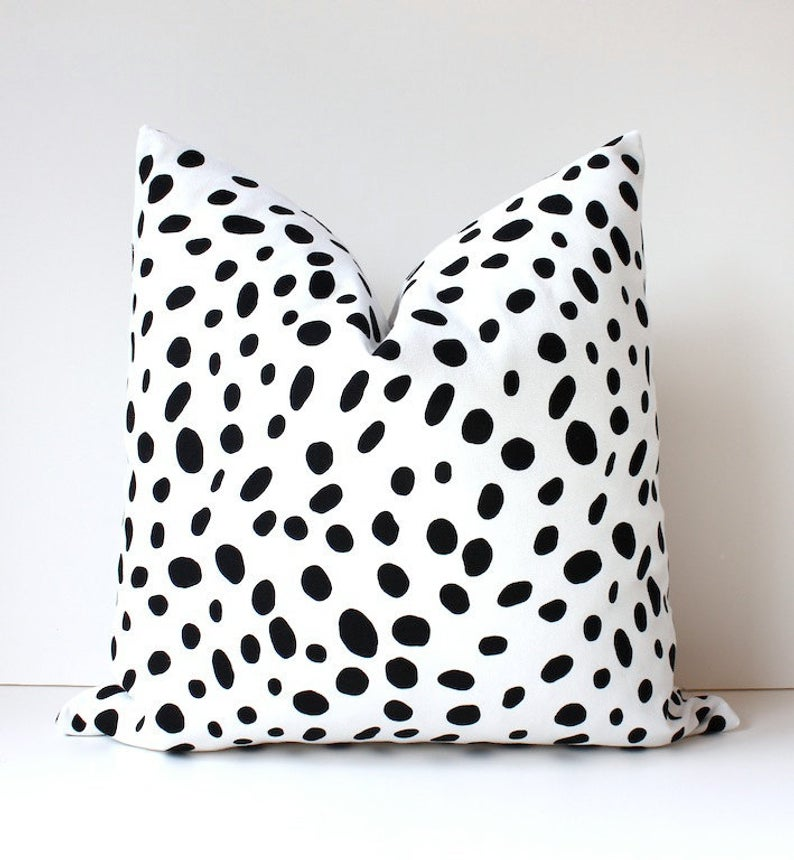black white spotted cushion