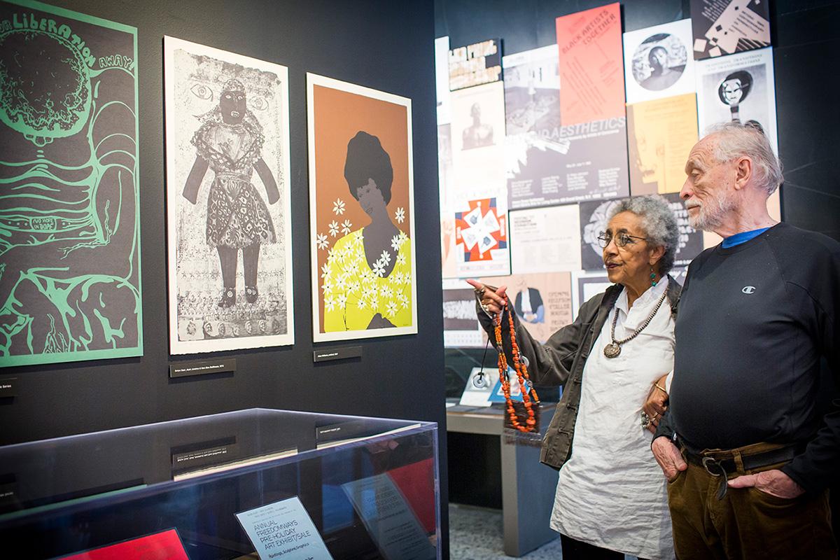 Camille Billops and James V. Hatch visiting the exhibition Still Raising Hell, September, 2016.