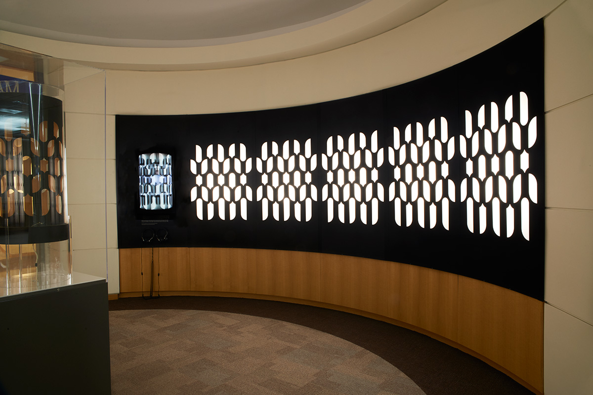 View of gallery showing light boxes featuring the pattern of the Dreammachine.