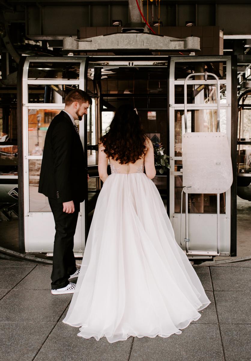 bride groom riding the gondola to wedding in vail colorado-1.jpg