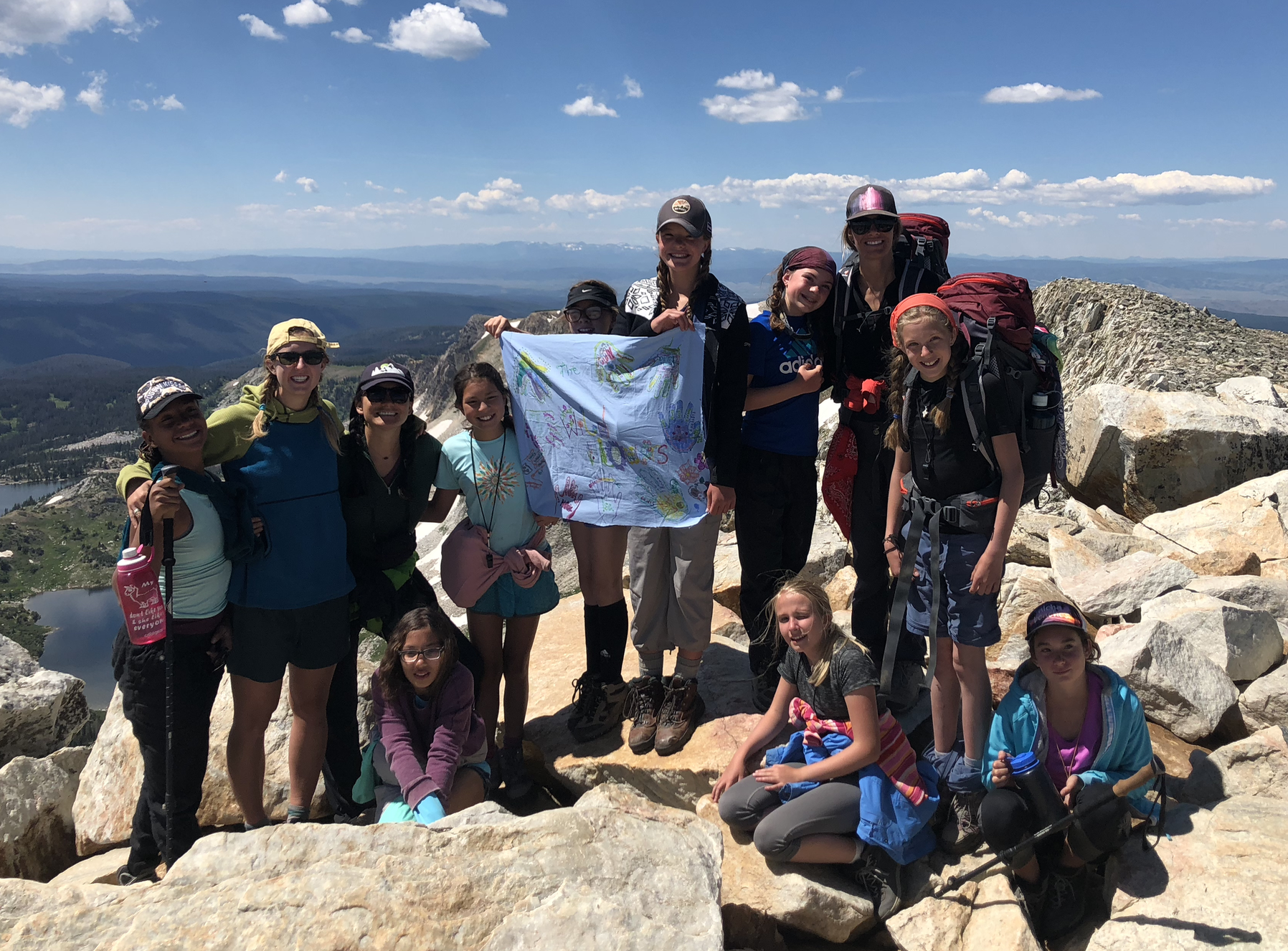 Audrey  (2nd from left)  taking middle school girls backpacking as part of self-discovery course in WY