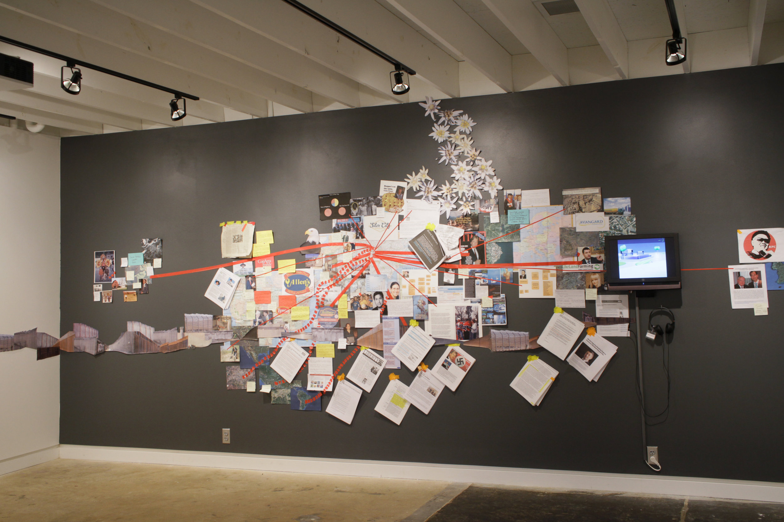 The North Wind and the Sun , Wall Map: paper, photographs, printed materials, video with sound, installation view,  The North Wind and the Sun , Art Lab, Columbus State University, Columbus, GA, 2017