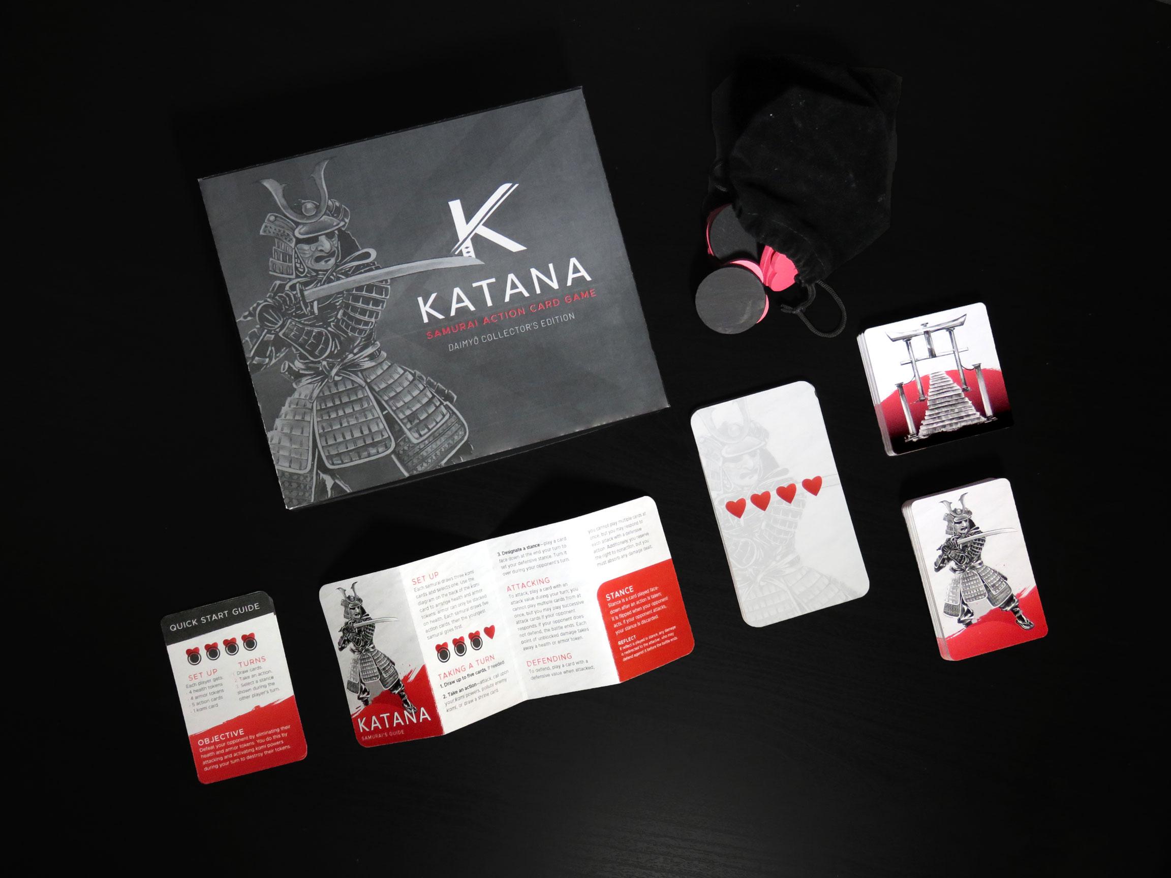 Katana—Daimyō Collector's Edition  includes: an Action deck (50 cards),  Kami  deck (12 cards), Shrine deck (24 cards), 10 Health tokens, 12 Armor tokens, Velvet Drawstring Token Bag Samurai's Guide, Quick Start Guide, Clamshell box