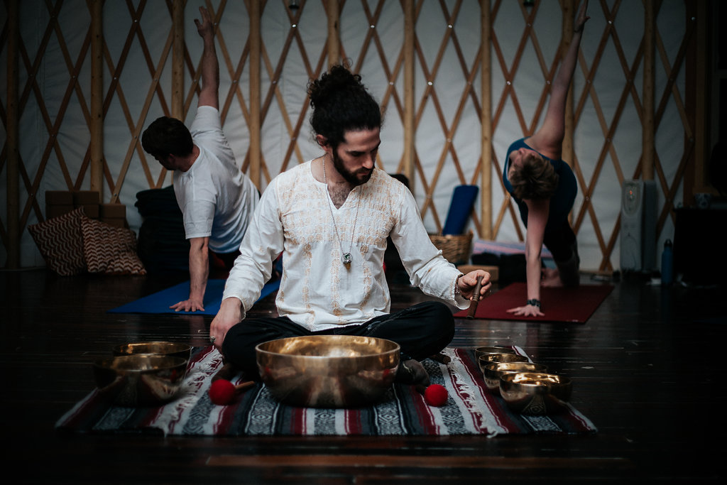 Practicing to the healing vibrations of our house Himalayan singing bowls.  Photo credit: Jenna Nord, First Embrace Photography.