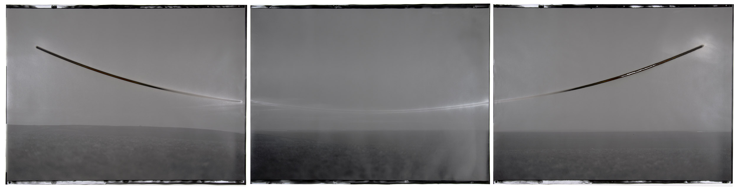 "Sunburned GSP#486 (Sunset/sunrise, North Slope, Alaska ), 2011. Three 30""x40"" unique gelatin silver paper negatives. Private collection"