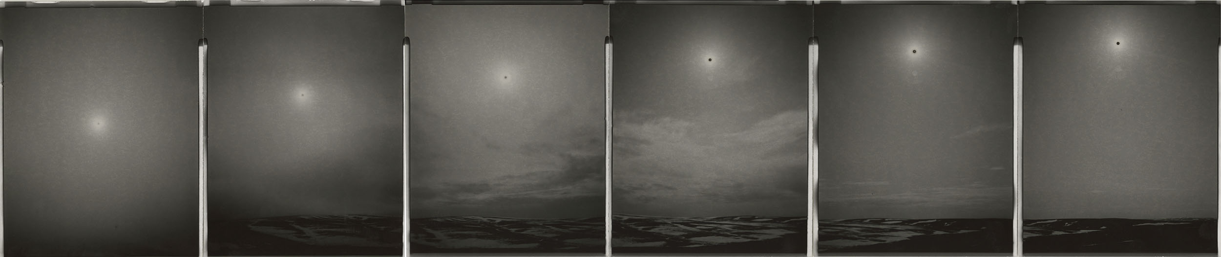 "Sunburned GSP #795(Clear skies descend into snow, North Slope, Alaska), 2014. Six 4""x5"" unique gelatin silver paper negatives. Private collection"