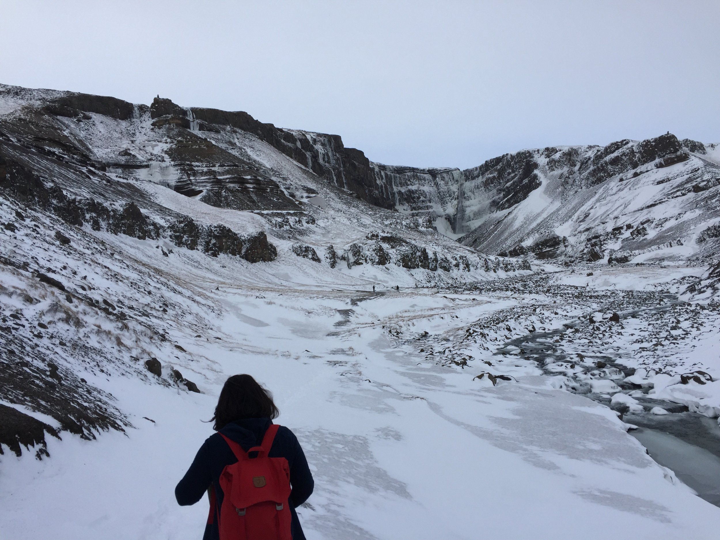 Hiking towards one of the tiers of Hengifoss waterfall.