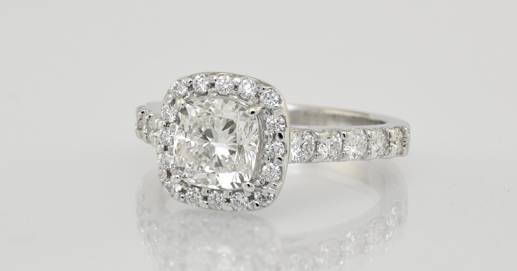 2 -.90 carat main diamond, cushion cut. Total diamond weight 1.30 carats