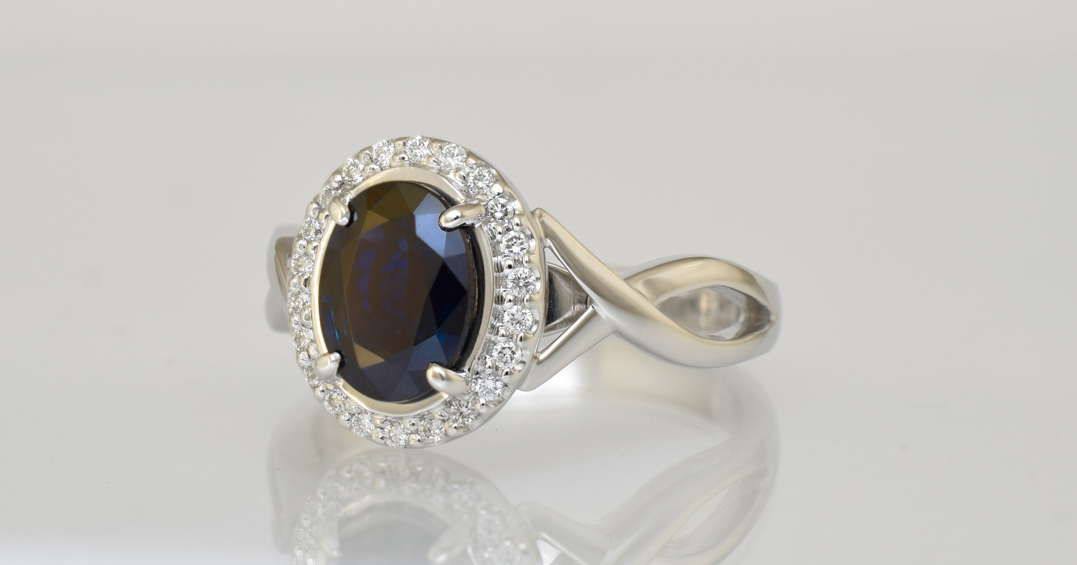 The ring remade in white gold with new F/Vs diamonds