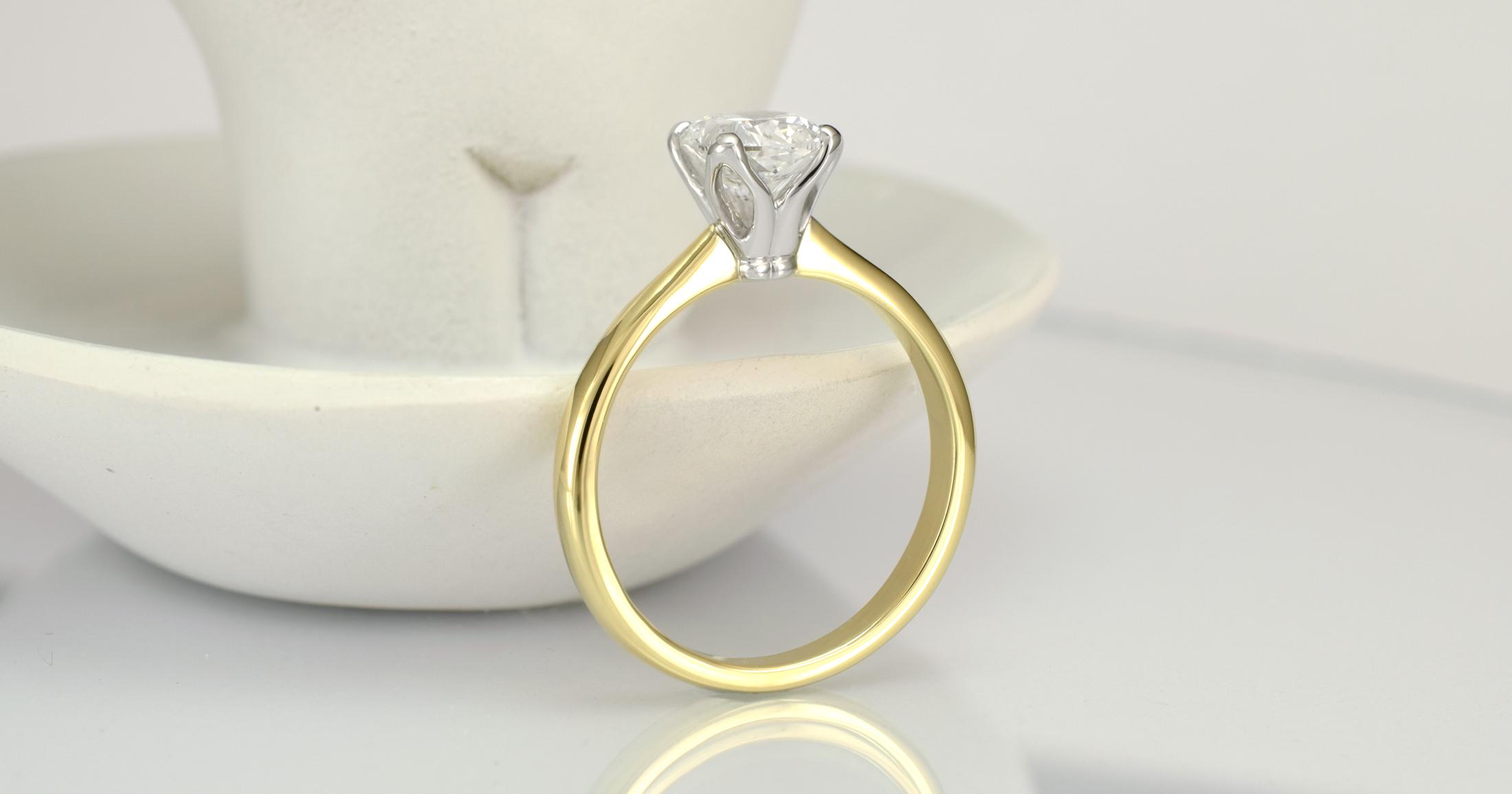 1 carat cushion cut in a temporary ring.