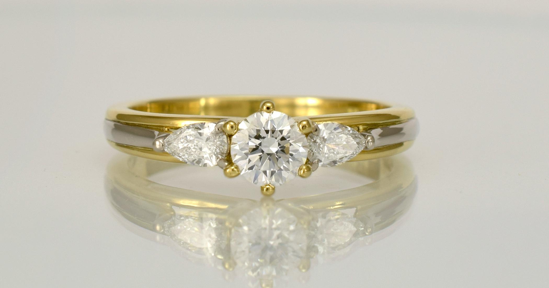 DR483 - 18ct gold alloys, .40ct main diamond with 2 x .125carat accent diamonds.