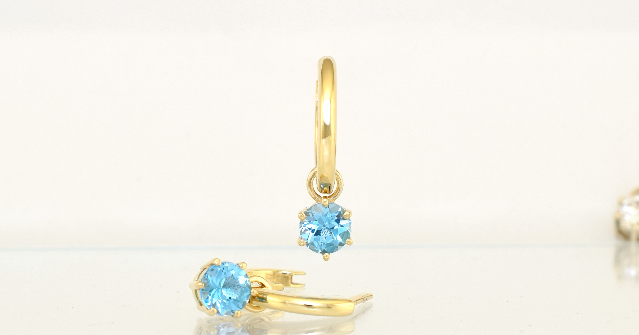 $330  Hoop and Pod pair in 9ct yellow gold set with any of the gemstones listed below.