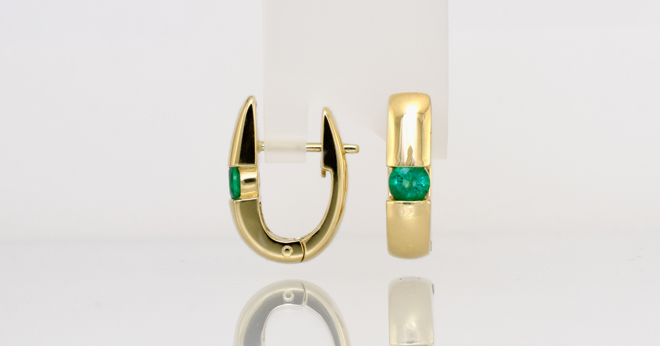 Natural 3.7mm Emeralds in 18ct yellow gold.