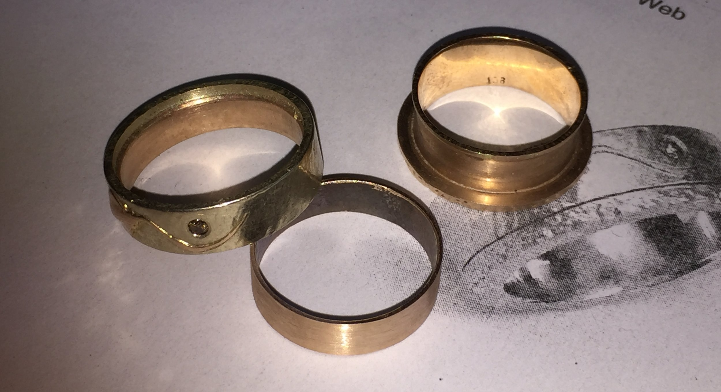The new sleeve in the middle ready to be added to the base of the ring on the right.