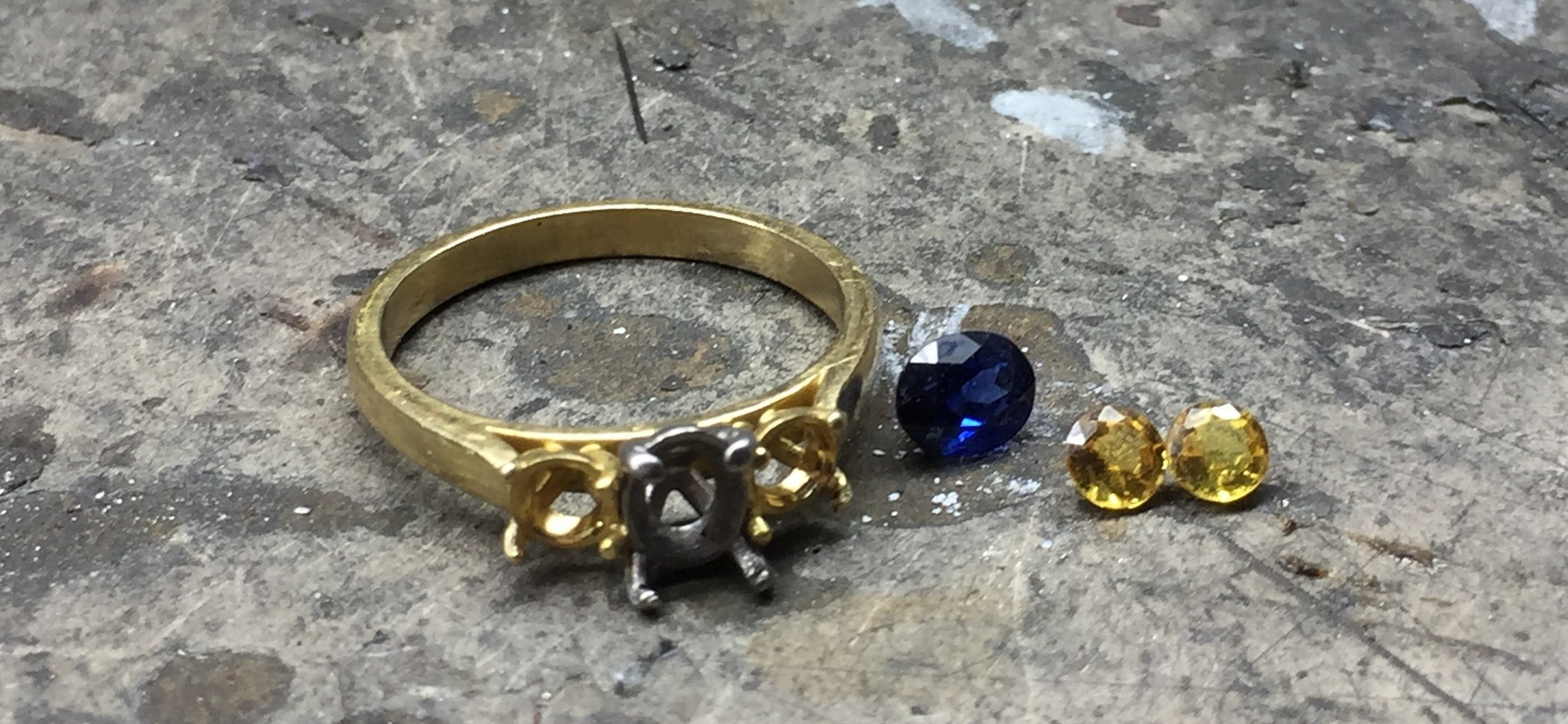 The ring unset and gems ready for inspection.