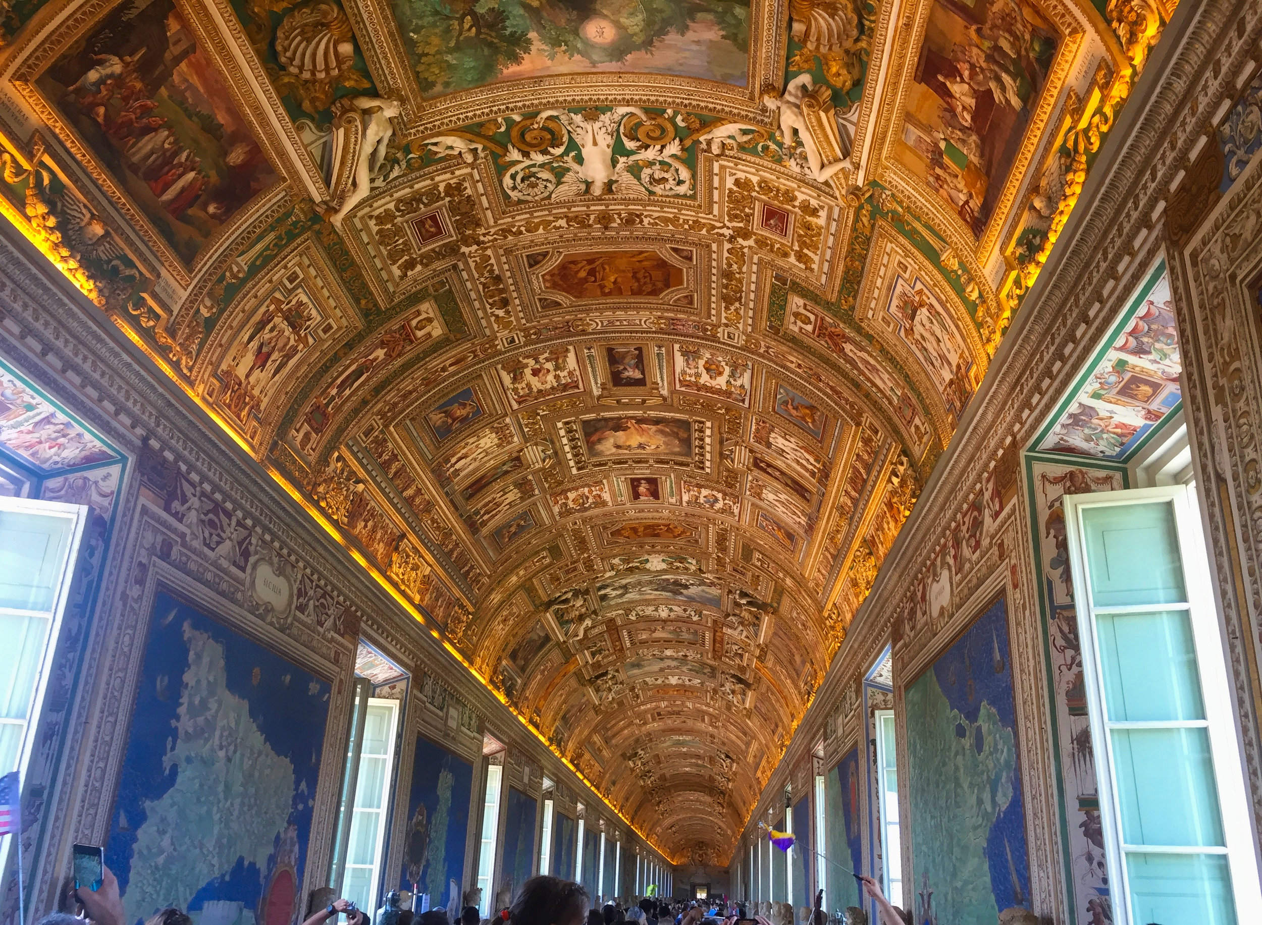The gallery of Maps of Italy. Just wall to wall people. The flags are so you know where you tour guide is.