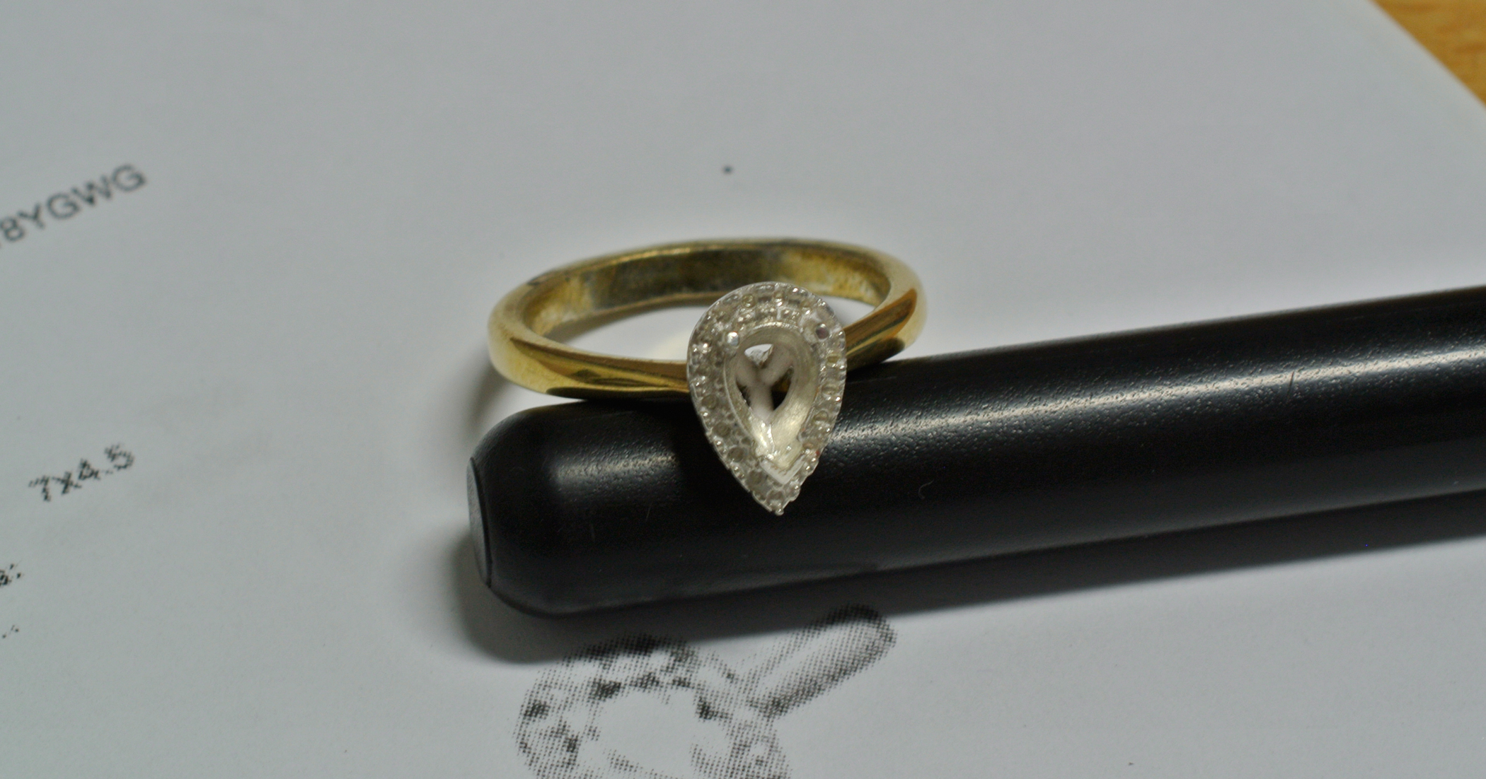 The draft ring made in Sterling Silver with the band gold plated.
