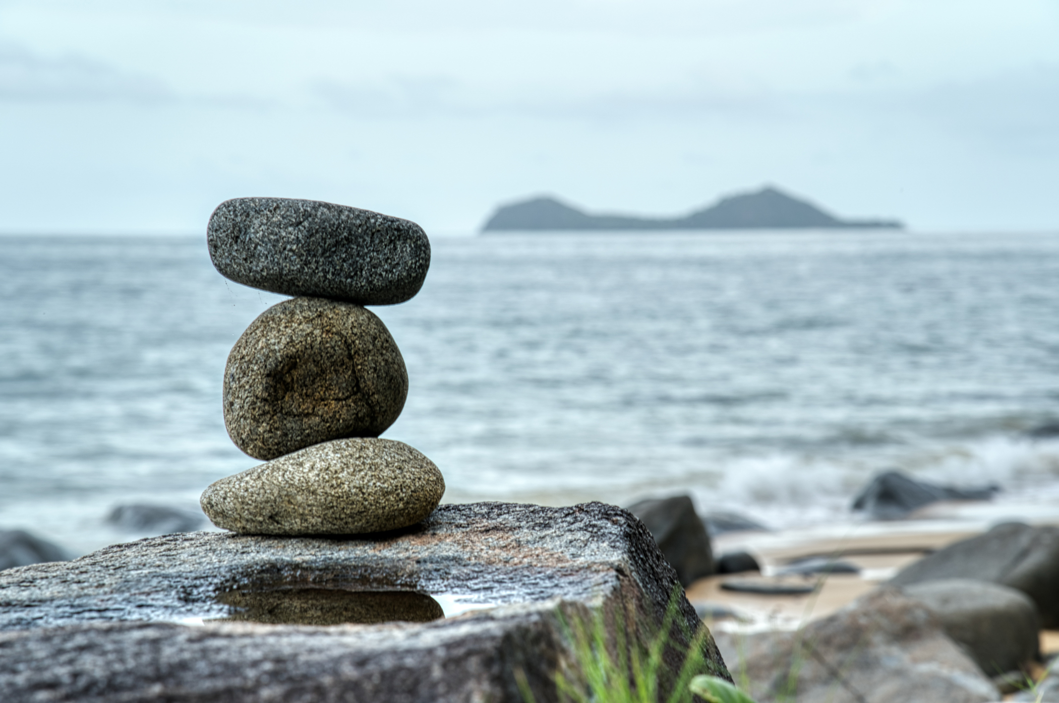 Someone visiting this isolated stretch of beach did this rockstacking.  I put one next to it.