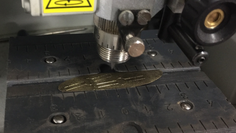 The plate being marked using a 3 axis mill.