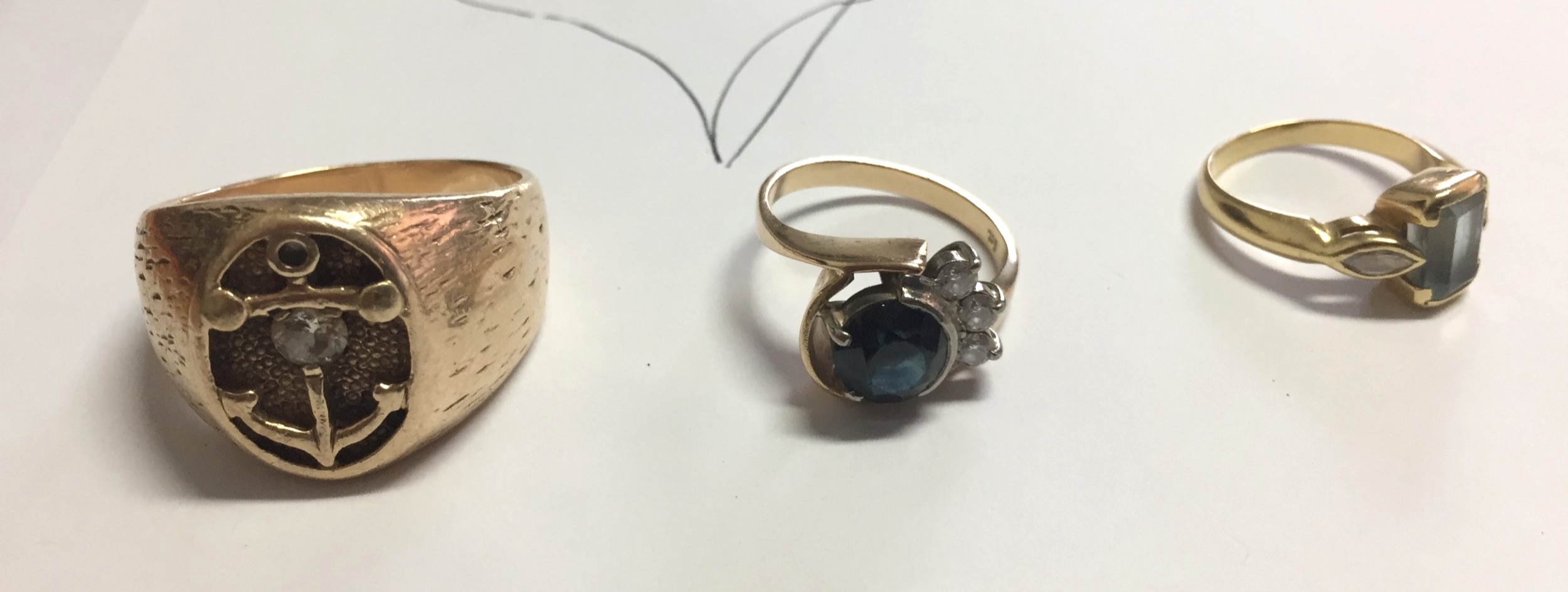 The ring to be remade on the left with some scrap jewellery.