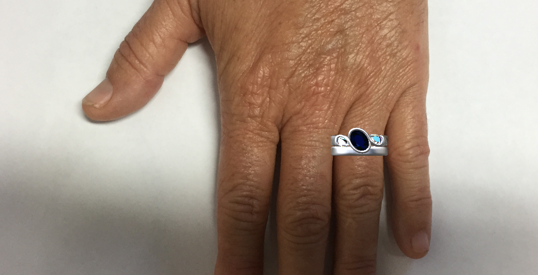 Mockup of the two rings to scale on her hand.