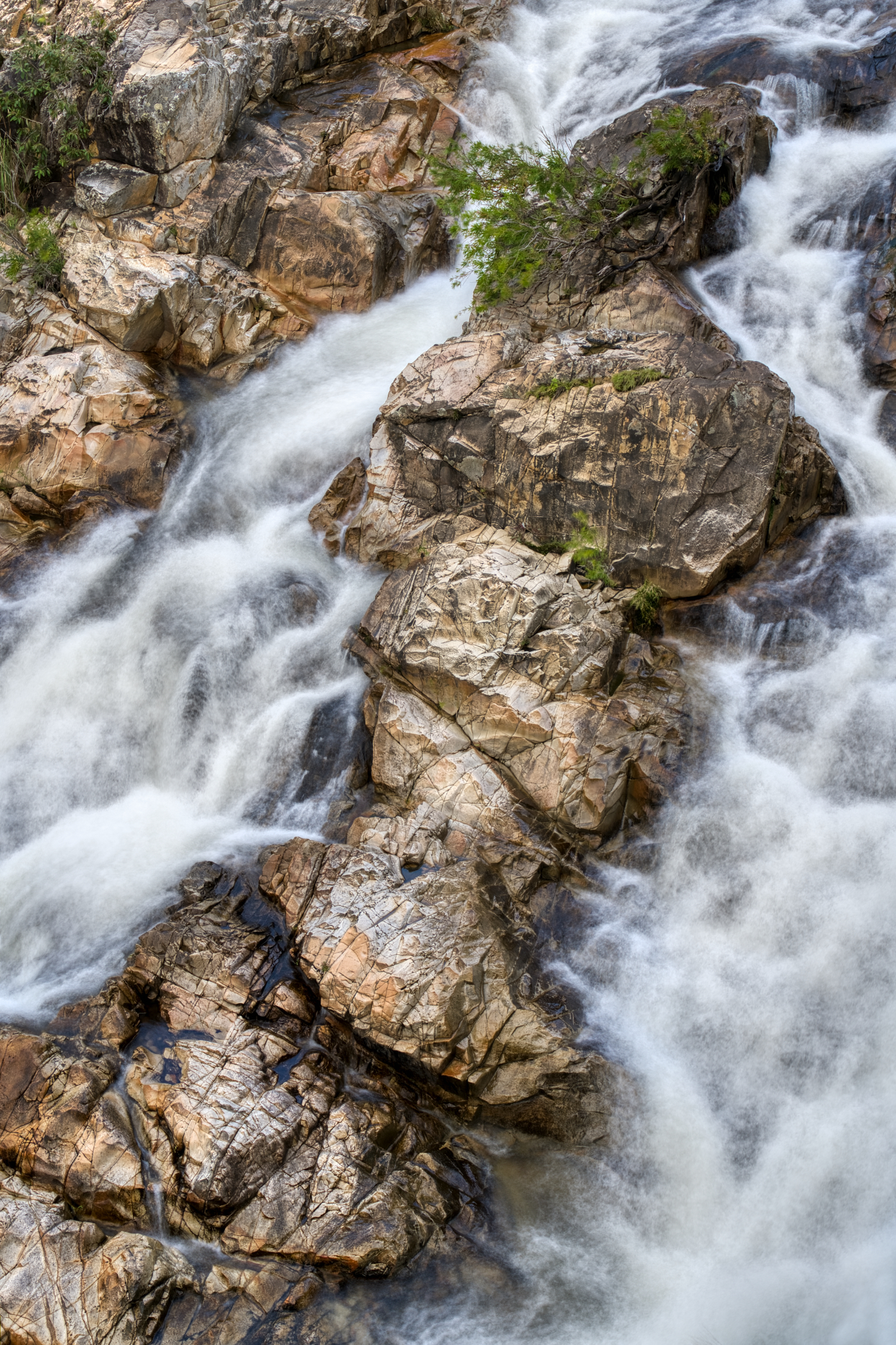 A small section of the falls with rocks protruding from the water.