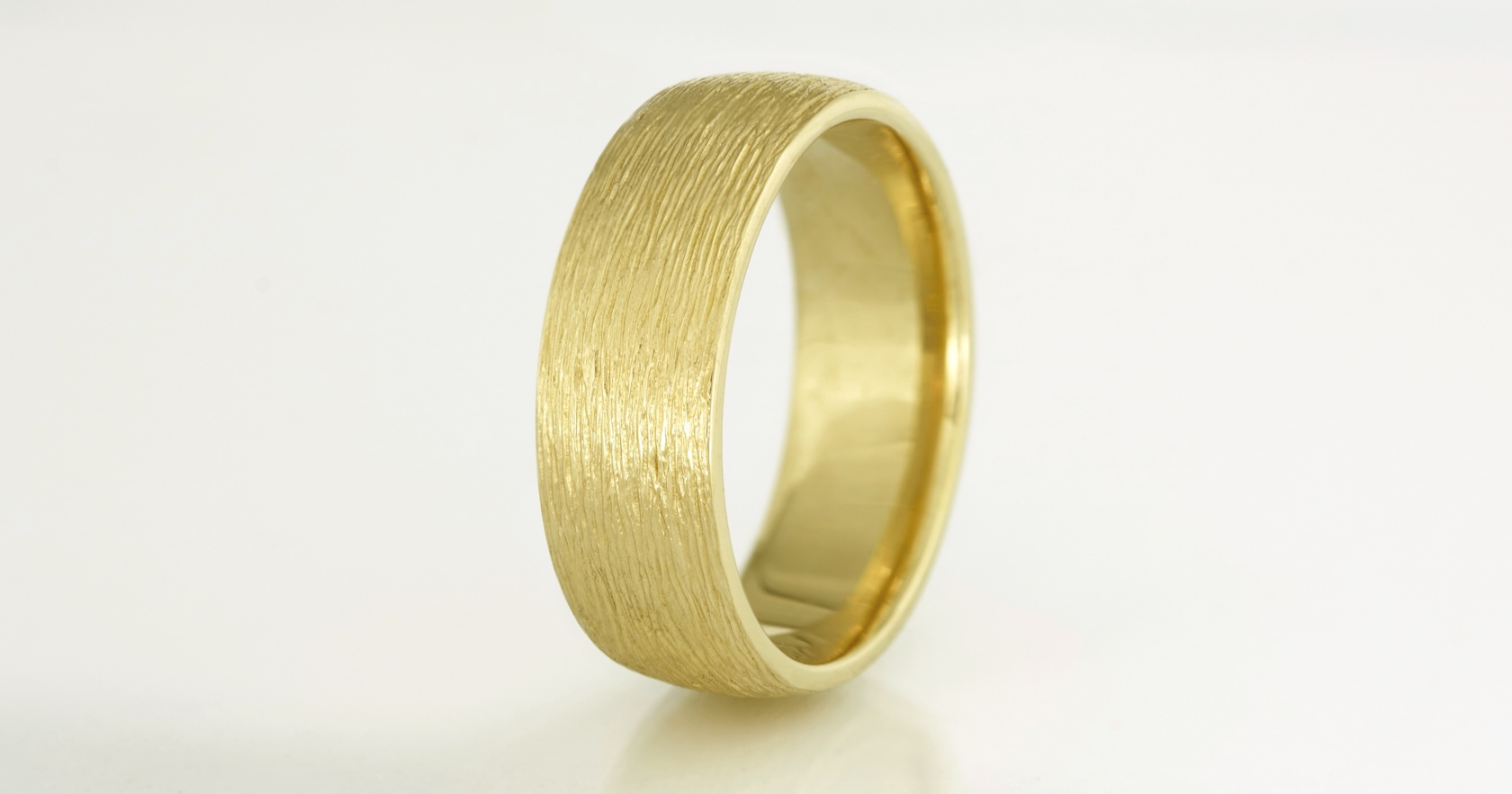The finished ring in 18ct yellow gold at 7.5mm wide.