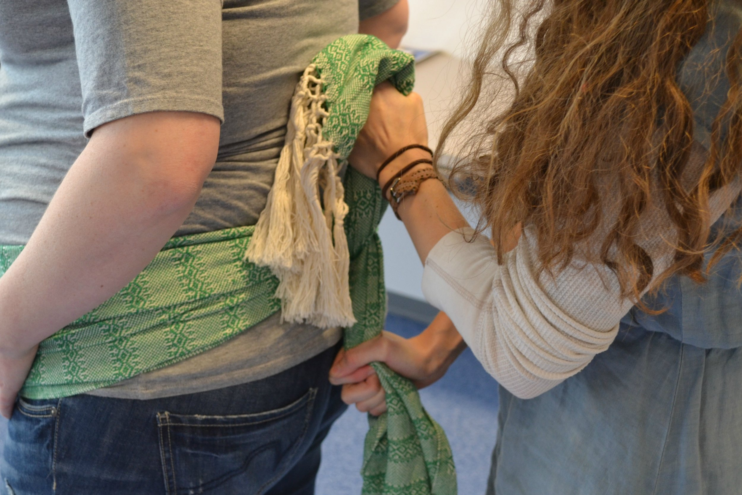This is the rebozo version of the double hip squeeze..it can be done in any position where the doula or partner has access to their backside....such as leaning over on a birth ball.