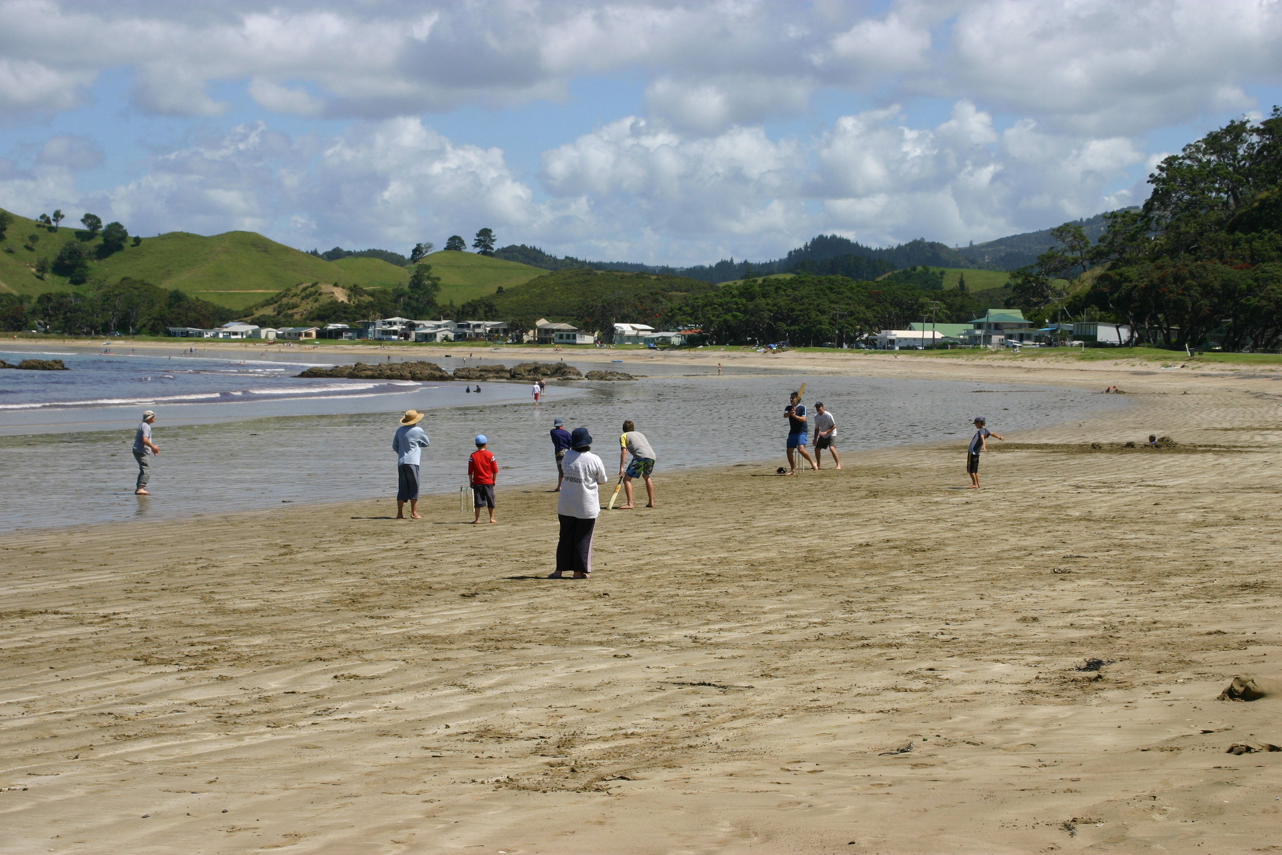 Quintessential New Zealand... family cricket on the beach