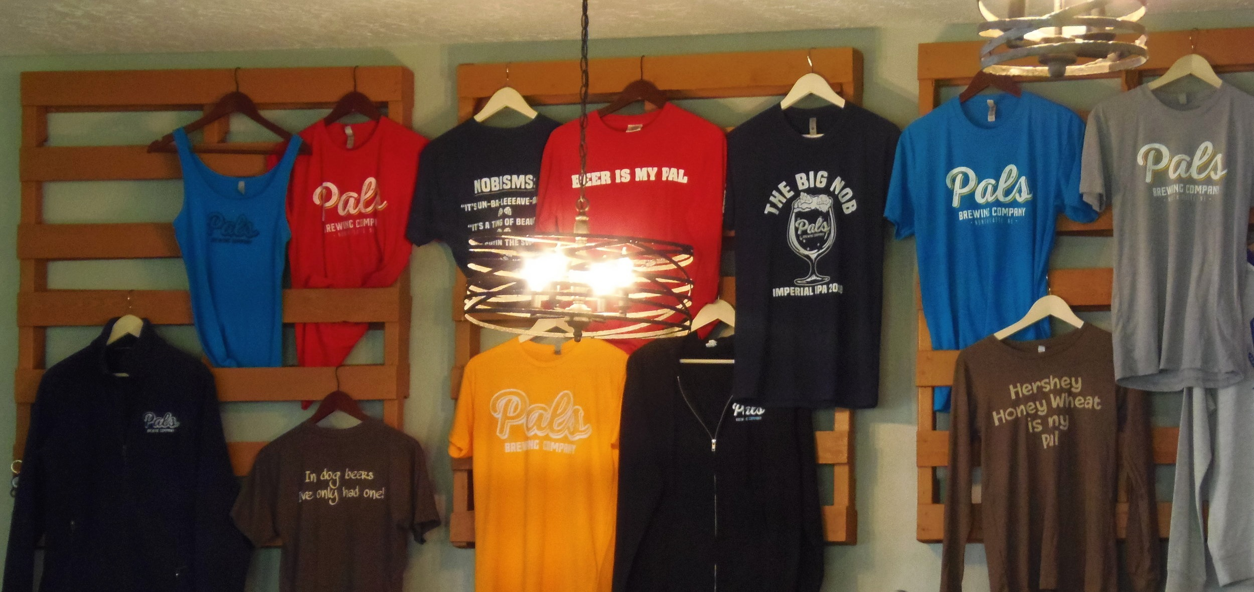 So many cool shirts to remember your stay at Pals Brewing Company