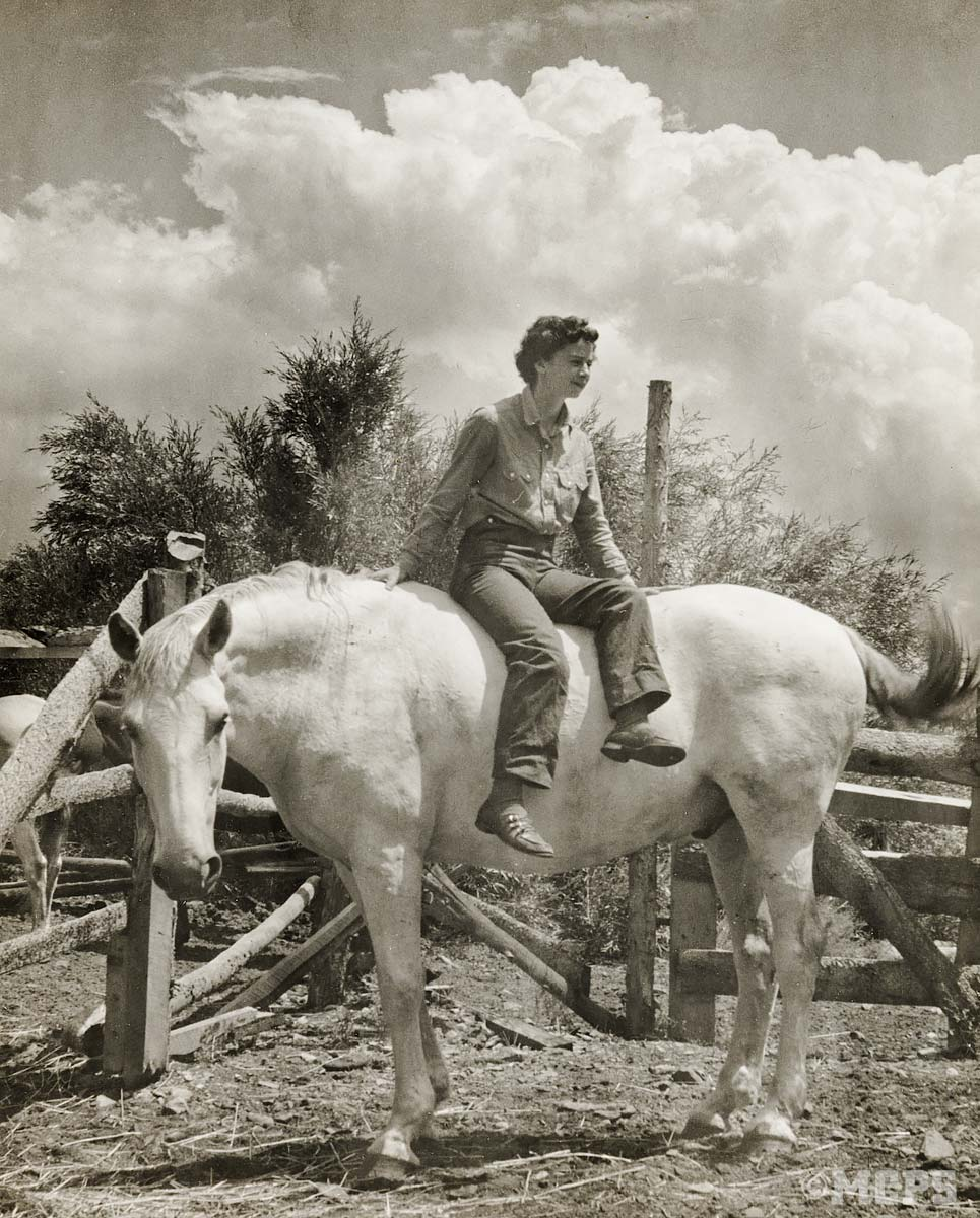 "Anne Johnson, former owner of McGee Creek Pack Station (1950 – 1969) ""horsing around"" in the corral"