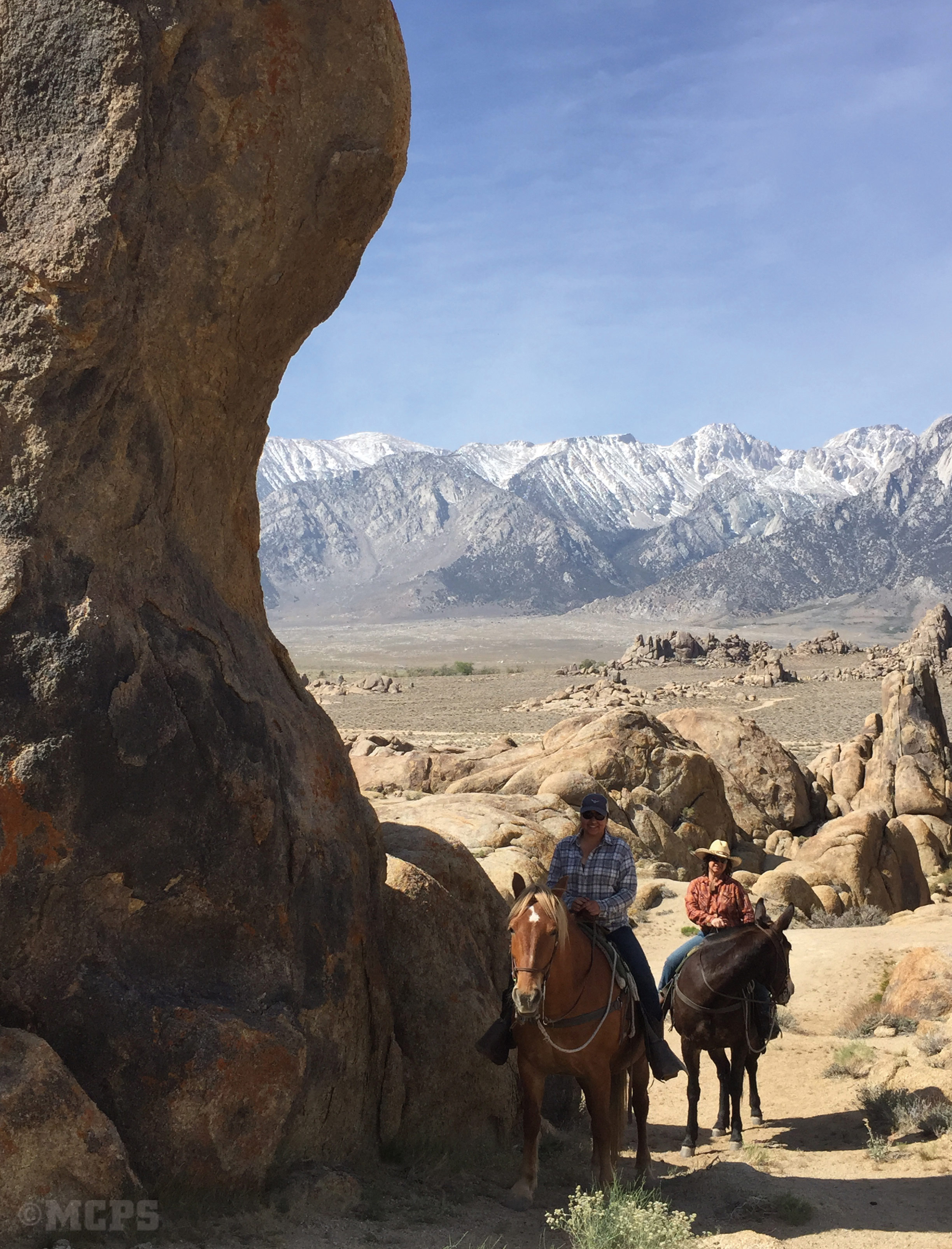riders exploring the Amazing geology  in the Alabama Hills