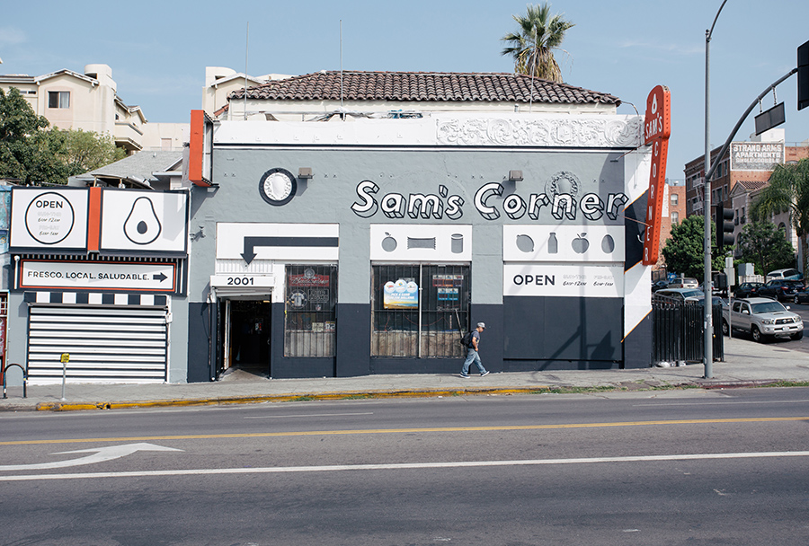 "For Sam's Corner Store near MacArthur Park, LA-Más helped showcase an expanded offering of fresh produce and healthy food options with bright exterior paint, bilingual signage, and ""fresh"" icons throughout.  Courtesy LA-Más"