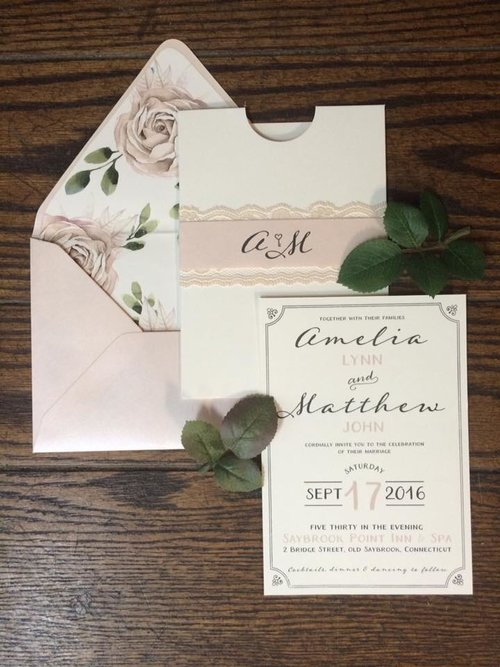 Amelia and Matthew incorporated floral envelope liners with their romantic, blush invitation suite.